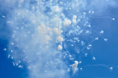 Fireworks and smoke in the blue sky in day time Ischia Italy. Blue sky with fireworks firecrackers and smoke in day time Ischia Italy Royalty Free Stock Photo