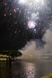 Fireworks and smoke on the water Royalty Free Stock Photo