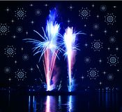 Fireworks  and snowflakes. Celebratory firework. Firework reflection in water Stock Image