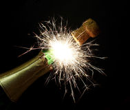 Fireworks sparks bottle chmpagne. New Year's and Christmas fireworks sparks from the bottle chmpagne Stock Photo