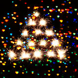 Fireworks sparks on hearts dark background. Christmas New Year's tree form fireworks sparks on hearts dark background Royalty Free Stock Photos
