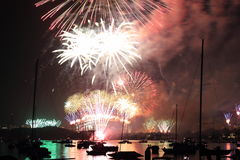 Fireworks display spread over city Stock Images