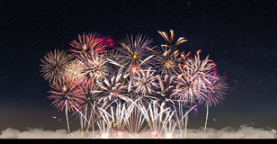 Fireworks and starry sky Stock Photos