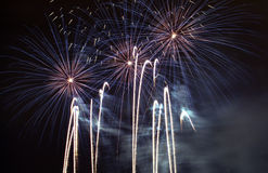 Fireworks. Streamers and bursts of fireworks in the night sky stock photography
