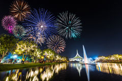 Fireworks at Suanluang Rama 9 in Constitution Day. Bangkok, Thailand - December 10, 2015: Fireworks show and prople looking at it at Suanluang Rama 9 park with stock images