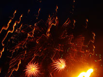 Fireworks at the Summer Event. Yellow and red fireworks explosion during the night time Royalty Free Stock Photo