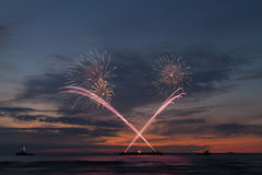 Fireworks at sunset royalty free stock image