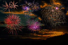 Fireworks at sunset sky background Stock Image