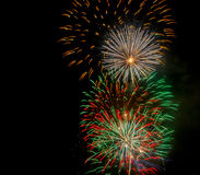 Fireworks on the 4th of July. Bright colored fireworks exploding in the night sky Royalty Free Stock Photography