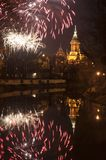 Fireworks. The TimiÈ™oara Orthodox Cathedral with fireworks and Bega river. Night scene with reflection on water royalty free stock photo