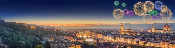 Fireworks under Arno River and Ponte Vecchio. Arno River, Ponte Vecchio, Vecchio Palace, Basilica of Santa Croce at sunset Florence stock image