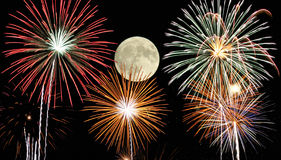 Fireworks under the moonlight. 4th of July fireworks display with moon Stock Image