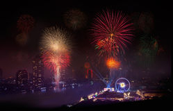 Fireworks in Urban City, Chao Phraya River, Bangkok,Thailand. Stock Photo