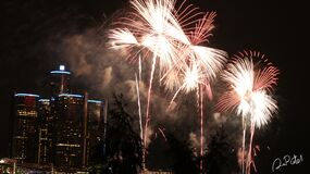 Fireworks in urban skies Royalty Free Stock Photography