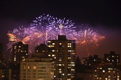 Fireworks celebration in the night sky in Vancouve. Purple irework show over the Vancouver skyline Stock Photo