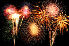 Fireworks of various colors. Fairworks of various colors bursting against a dark background Stock Photos