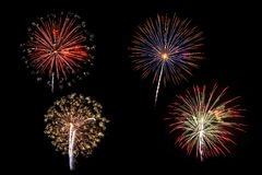 Fireworks of various colors isolated on blac Royalty Free Stock Photography