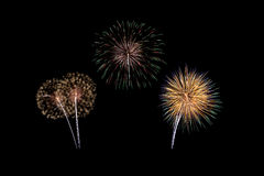 Fireworks of various colors isolated on black Royalty Free Stock Photo