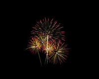 Fireworks of various colors isolated on black Royalty Free Stock Photos