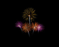 Fireworks of various colors isolated on black Royalty Free Stock Photography