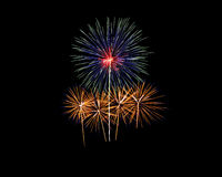 Fireworks of various colors isolated on black Stock Photos