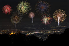 Fireworks of various colors over the city Stock Photos
