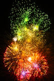 Fireworks of various colors over night sky. Fireworks of various colors from green to pink over night sky Royalty Free Stock Photography