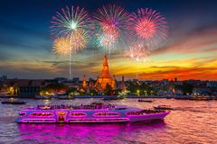 Fireworks at Wat arun and cruise ship in sunset time under new year celebration. Bangkok city ,Thailand Stock Photo