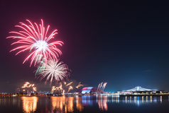 Fireworks by water in Singapore city Royalty Free Stock Image