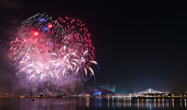 Fireworks by water in Singapore city Royalty Free Stock Photos