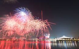 Fireworks by water in Singapore city Royalty Free Stock Images