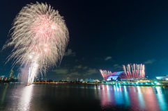 Fireworks by water in Singapore city Royalty Free Stock Photography