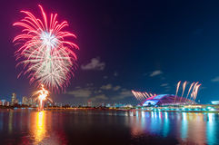 Fireworks by water in Singapore city Stock Image