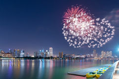 Fireworks by water in Singapore city Stock Photos