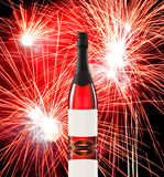 Fireworks and wine bottle Stock Photography