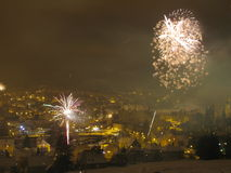 Fireworks in the winter night sky Royalty Free Stock Image