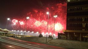 Fireworks at Yas Marina Circuit Red dots and smoke. Celebration Red dots coloured colour Fireworks at Yas Marina Circuit near the entrance drive safely banner at Stock Photography