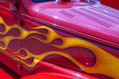 Firey Red Street Rod with Yellow Flames. This is a beautiful classic vintage red street rod with yellow and orange flames royalty free stock images