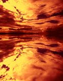 Firey sunset reflection Stock Photos