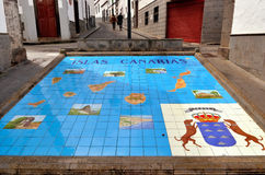 Firgas, Paseo de Canarias. FIRGAS - FEB 26 2014: The Paseo de Canarias with representations of the 7 Canary Islands carved into the ground  with their heraldic Stock Images