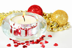 Firing candle, Christmas decorations Royalty Free Stock Image