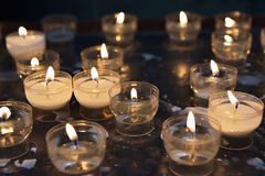 Firing candles in catholic church Royalty Free Stock Images