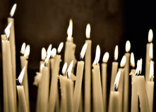 Firing candles in catholic church Stock Photo