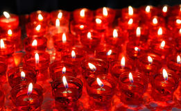 Firing candles in catholic church Royalty Free Stock Image