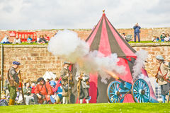 Firing the cannon. Royalty Free Stock Photos