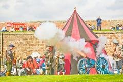 Firing the cannon. Royalty Free Stock Photos
