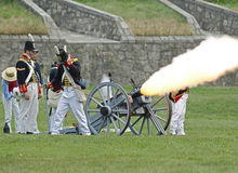 Firing Cannon. FORT ERIE, ONTARIO, CANADA - August 6/2011- An American gun crew fires during an artillery demonstration in Fort Erie at the annual Siege of Fort royalty free stock images