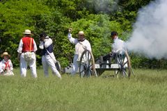 Firing a cannon at a War of 1812 re-enactment Stock Images