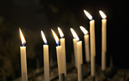 Firing church candles Royalty Free Stock Photography
