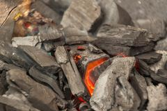 Firing coal on the grill. Barbecue Fire Grill top view. Royalty Free Stock Photo